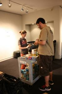 Leah Belcher and James Peth installing art in Thacher Gallery