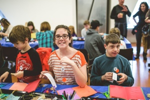 Siblings making art together at CJM's Family Access Day