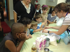 Laura Harvery making  ice cream during the Family Access Day: Making a Cool Treat program in Brooklyn