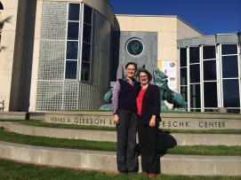 Dr. Zheng Liping of the Hebei Association of Science & Technology with Marjorie Schwarzer in front of USF's Gleeson Library.