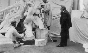 August Rodin overseeing work in his Paris studio