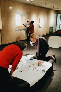 Nell Herbert working with curator Kristina Foss on the Interwoven layout.