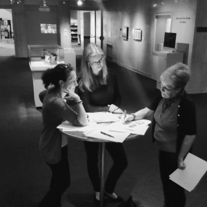 Conservator Elizabeth Cornu advising Glori Simmons and Nell Herbert on how to safely pack and transport the Interwoven baskets.