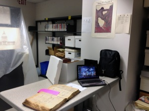My workspace at one corner of the archival stacks. On the table is one of the San Francisco Police Department Detective Bureau's scrapbooks from 1915—a rich source of human interest tales from the Fair.