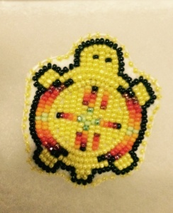 This exquisitely beaded yellow turtle is one of the special pins presented by Jordan's family to the Class of 2015.