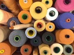 Spools of thread salvaged from the LS&Co. factory on Valencia Street when it closed in 2002.